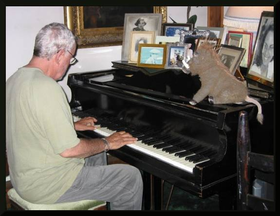 Trying to teach the other guy a few tunes on the piano  (c) 2004 David Coyote